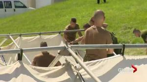 Canadian Army acquire haven seekers during Lacolle border