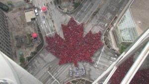 Timelapse: Living flag takes over Winnipeg's Portage and Main