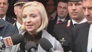Dancer speaks to reporters after testimony at trial of Costa Concordia captain