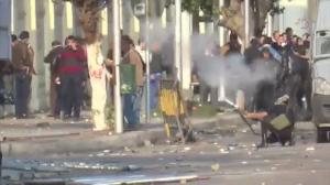 Raw video: Egyptian police use tear gas as protesters converge on defence ministry