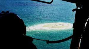 Five rescued after scrawling massive SOS message across remote sandbar
