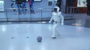 Obama plays football with robot during Japan visit