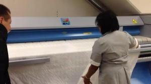 High-tech machines dries and folds linens