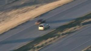 Man changes cars, drives into oncoming traffic in dramatic high-speed chase
