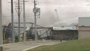 Firefighters continue to control a warehouse fire in Mississauga