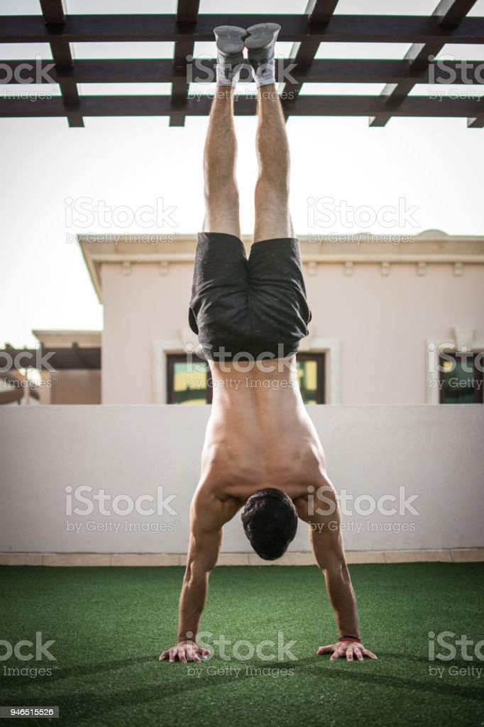 Stock Images Of Exercise Back Of Handsome Shirtless Man Doing Handstand Exercise