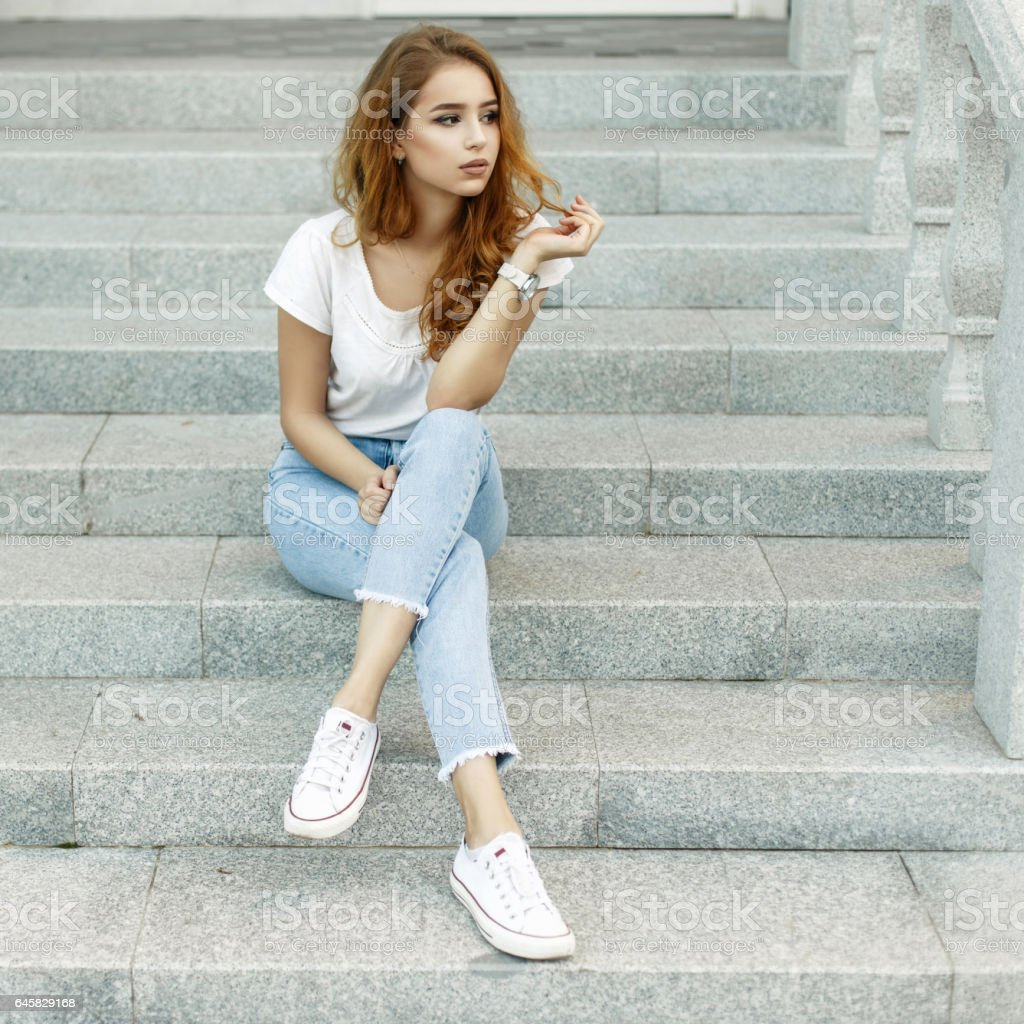 Stylish Clothes Beautiful Young Woman With Red Hair In A Stylish Clothes Sits On