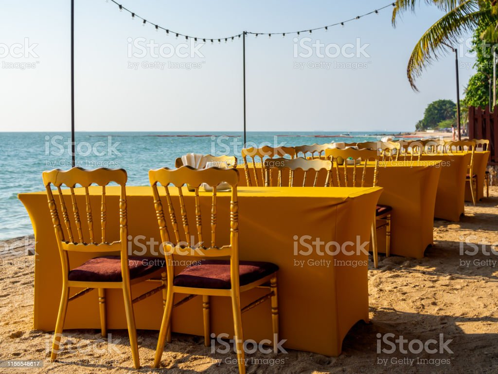Dining Table With Four Chairs On The Beach Stock Photo Download Image Now Istock