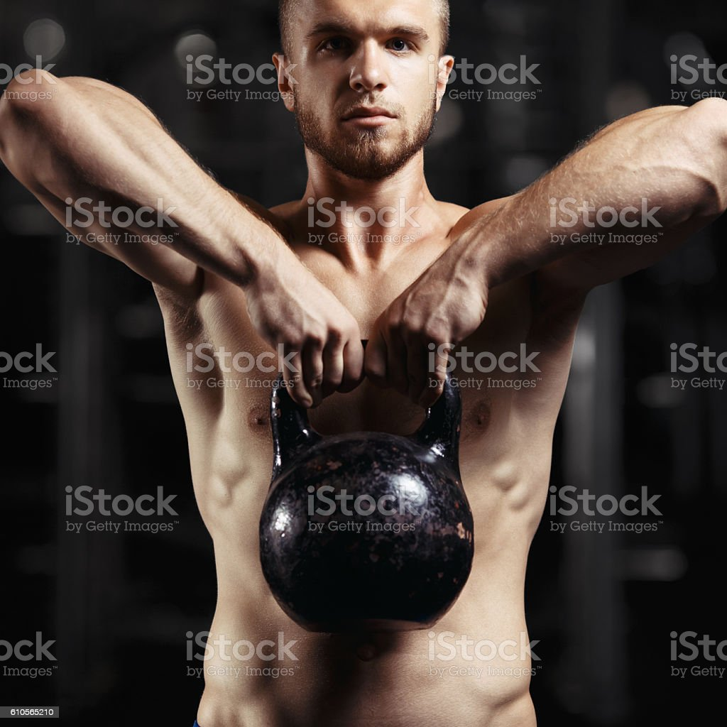 Kettlebell Bodybuilding Fitness Man Doing A Weight Training By Lifting Heavy Kettlebell
