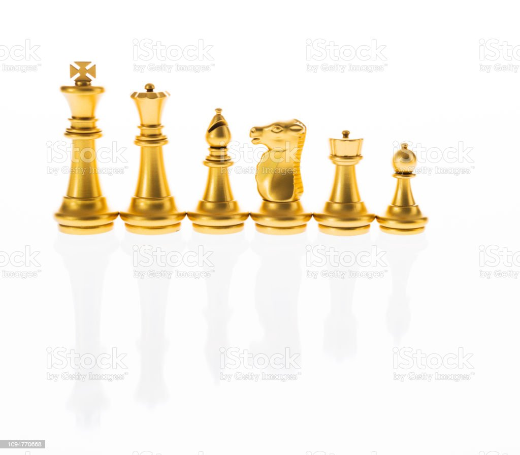 Gold Chess Pieces Golden Chess Pieces In A White Background Stock Photo More