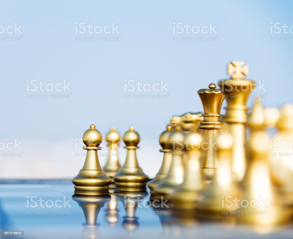 Gold Chess Pieces Golden Pieces Standing On The Board Stock Photo More Pictures Of Battle