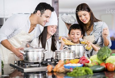 Happy Family Cooking Stock Photo & More Pictures of Adult - iStock