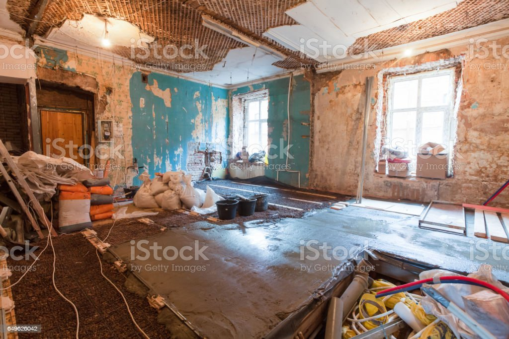 Interior Of Apartment With Materials During On The Renovation And Construction Stock Photo - Garage Ombouwen Tot Woning