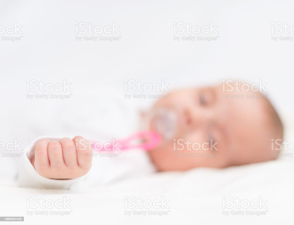 Newborn Babies For Dummies Newborn Little Baby With Dummy Sleeping On The Bed Stock Photo Download Image Now