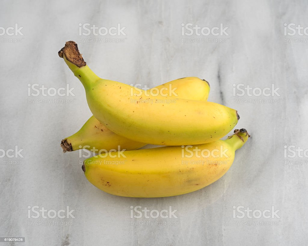 Small Marble Cutting Board Small Bananas On A Marble Cutting Board Stock Photo More