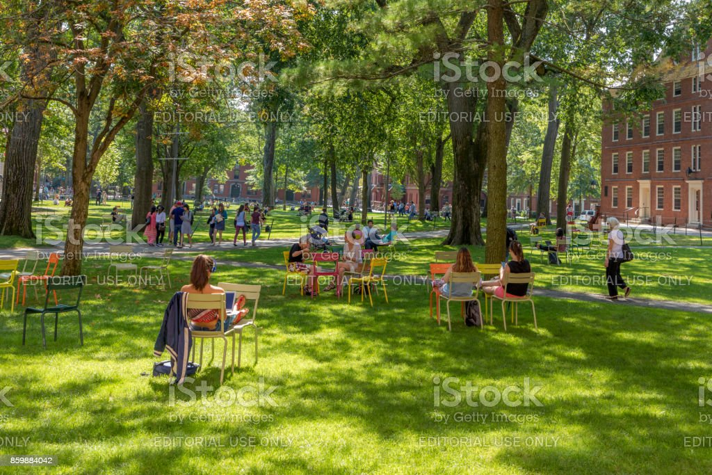 Students And Tourists Rest In Lawn Chairs In Harvard Yard
