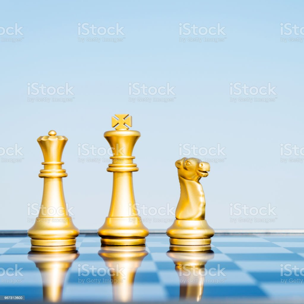 Gold Chess Pieces Three Chess Pieces Standing On The Board Stock Photo More Pictures Of Aggression