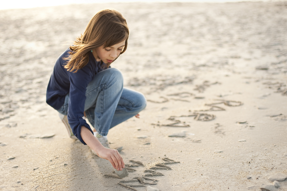 Cute Stylish Child Girl Wallpaper Drawing In The Sand