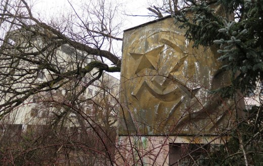 Vegetation has overtaken a monument depicting the Soviet hammer and sickle in Pripyat. // Claudia Himmelreich / McClatchy
