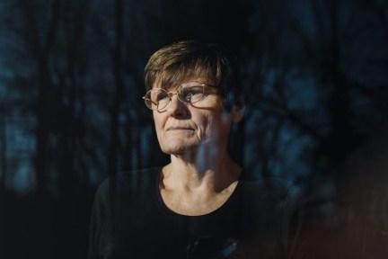 Portrait of Katalin Kariko looking through a window