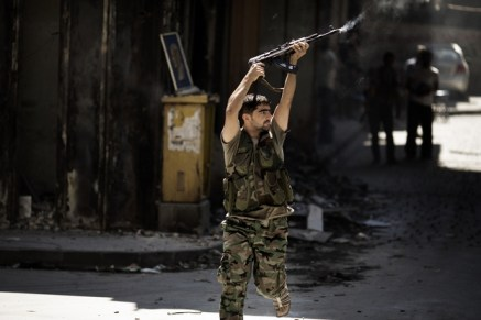 A Syrian rebel fires toward a position held by regime forces during clashes in the northern city of Aleppo on Sept. 14.