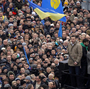 Vitali Klitschko, head of the opposition UDAR party, waves a flag during a rally in downtown Kiev, Ukraine, on Dec. 1. The WBC heavyweight boxing champion has emerged as one of Ukraine's most popular political figures, as massive anti-government protests grip the country.