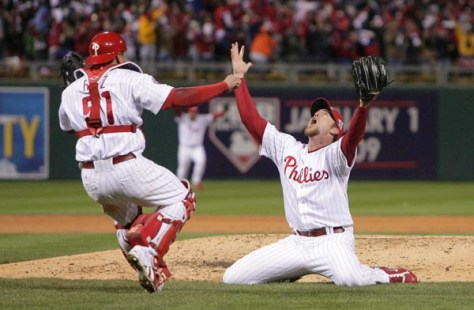 Brad Lidge and Carlos Ruiz celebrate winning it all after the end of the ninth inning.