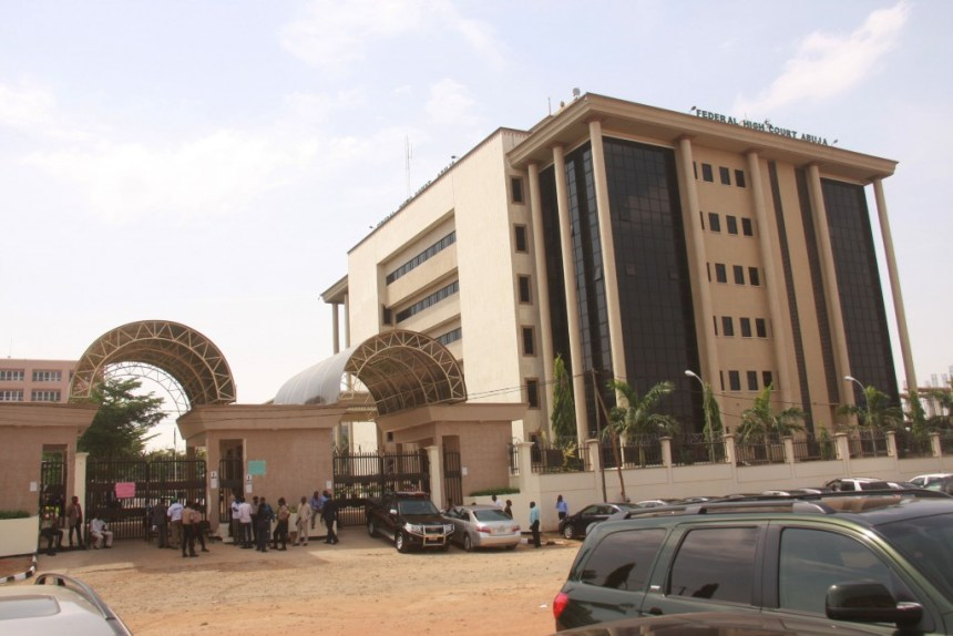 The entrances of the Federal High Court, Abuja, locked up by striking workers ... on Monday