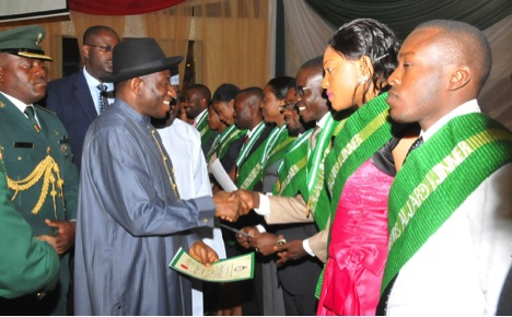 President Goodluck Jonathan presenting awards to NYSC awardees at the 2012 Presedential awards day at the state house Abuja.
