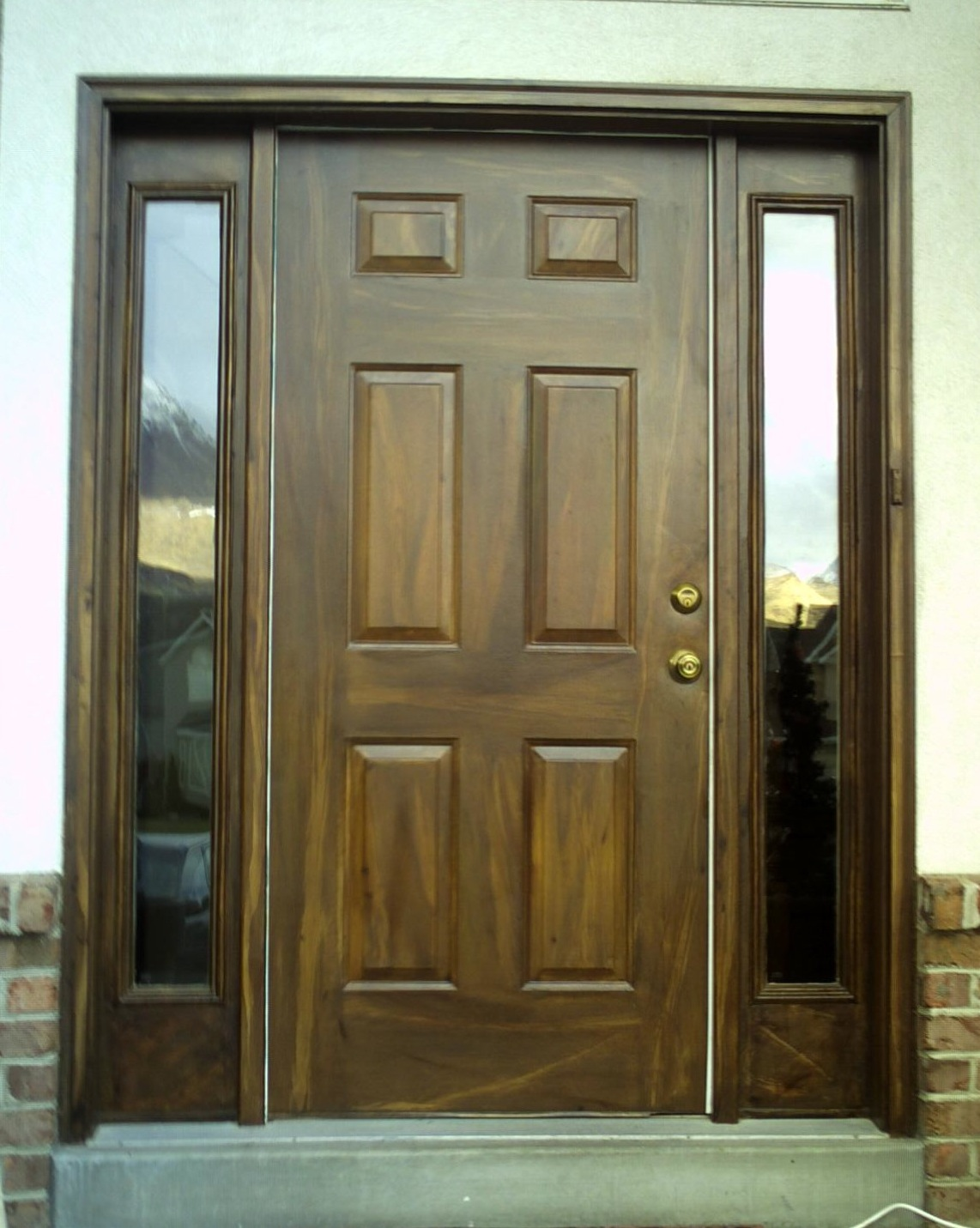 Garage And Front Doors That Match Matching Woodgrained Entrance Garage Doors