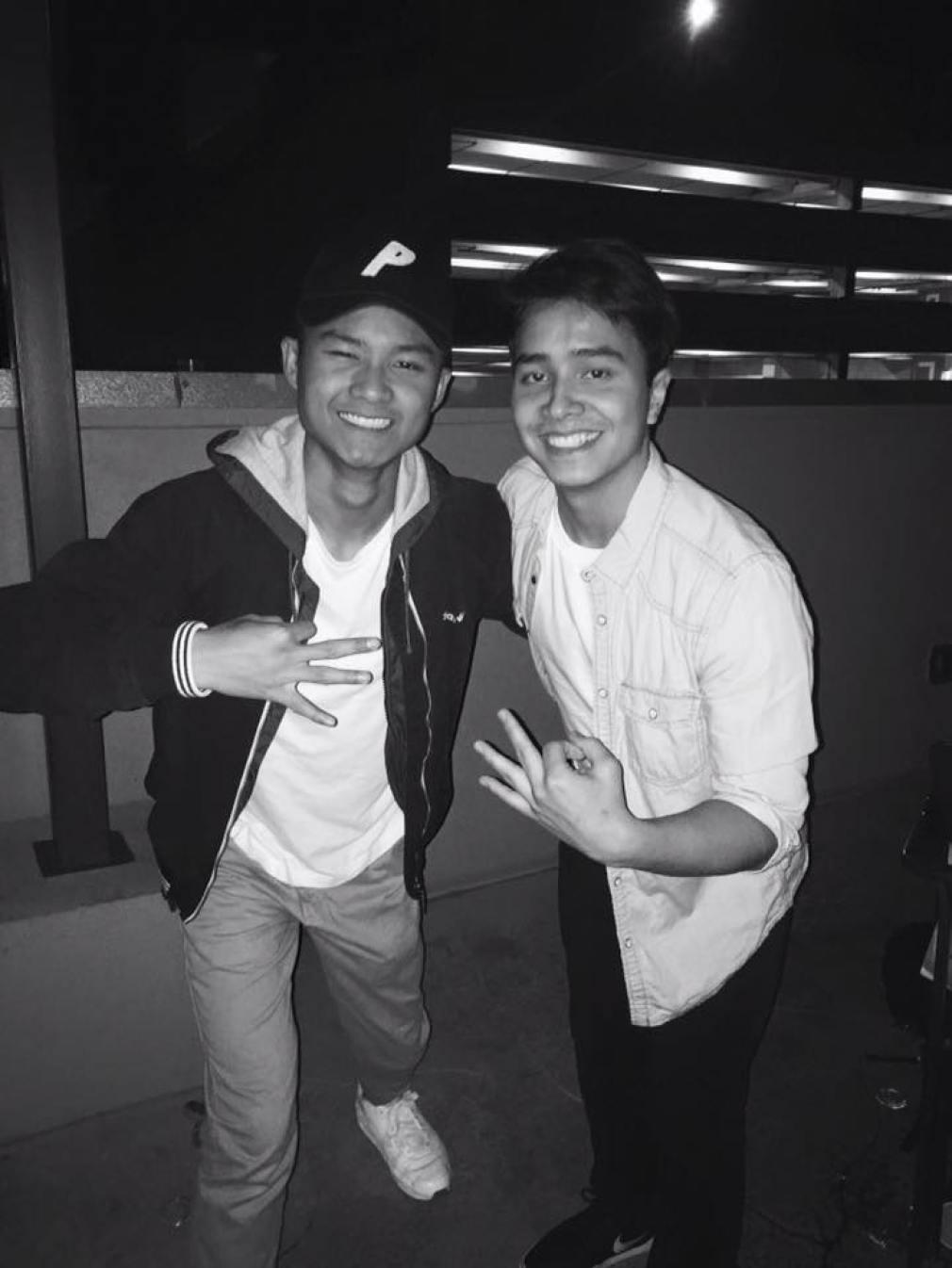 Jeff Maqui (left), UT Finance Sophomore, rocks a Palace hat
