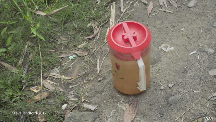 Jugs of diesel fuel are seen on a path in the town of Maungdaw, Western Myanmar. (Photo: Steve Sandford / VOA)