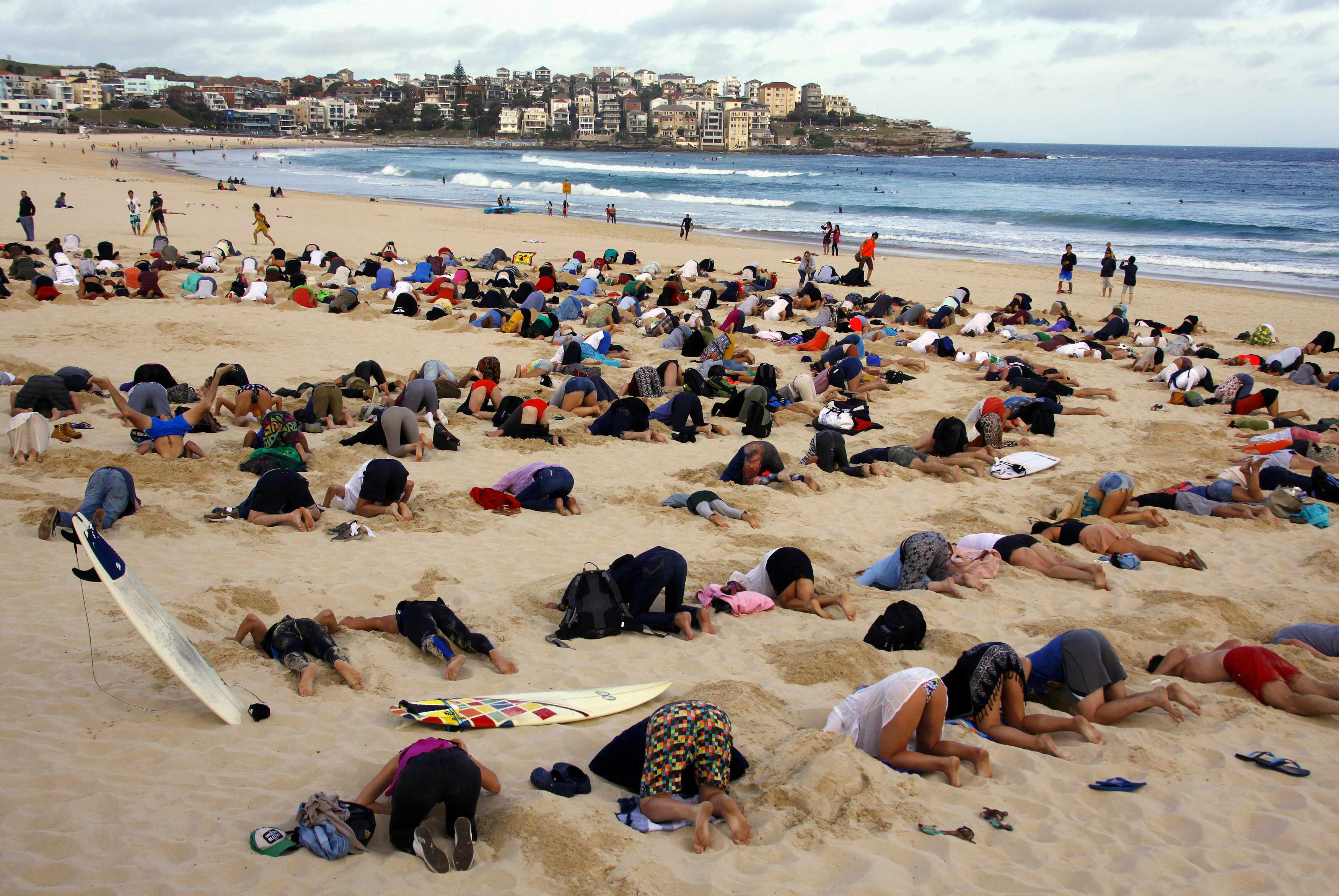 Is Australia A Democratic Country Australians Bury Heads In Sand To Mock Government Climate
