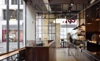 Industrial style in London coffee bar with glass wall and ...