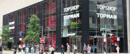 CHICAGO, USA - JUNE 26, 2013: People walk by Topshop Topman store at Magnificent Mile in Chicago. The Magnificent Mile is one of most prestigious shopping districts in the United States.