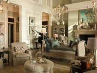 The dramatic living room features soaring ceilings and ...