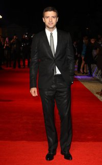 Justin looked debonair in a black suit and silver tie at