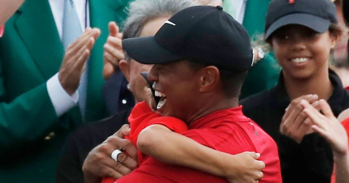 tiger woods hugging kids