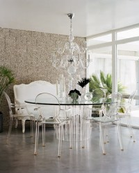 The pairing of a Lucite table and a set of Louis Ghost ...
