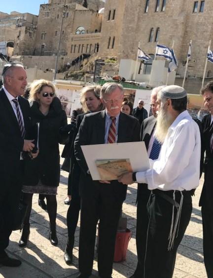 Image: John Bolton is shown around Jerusalem's Western Wall