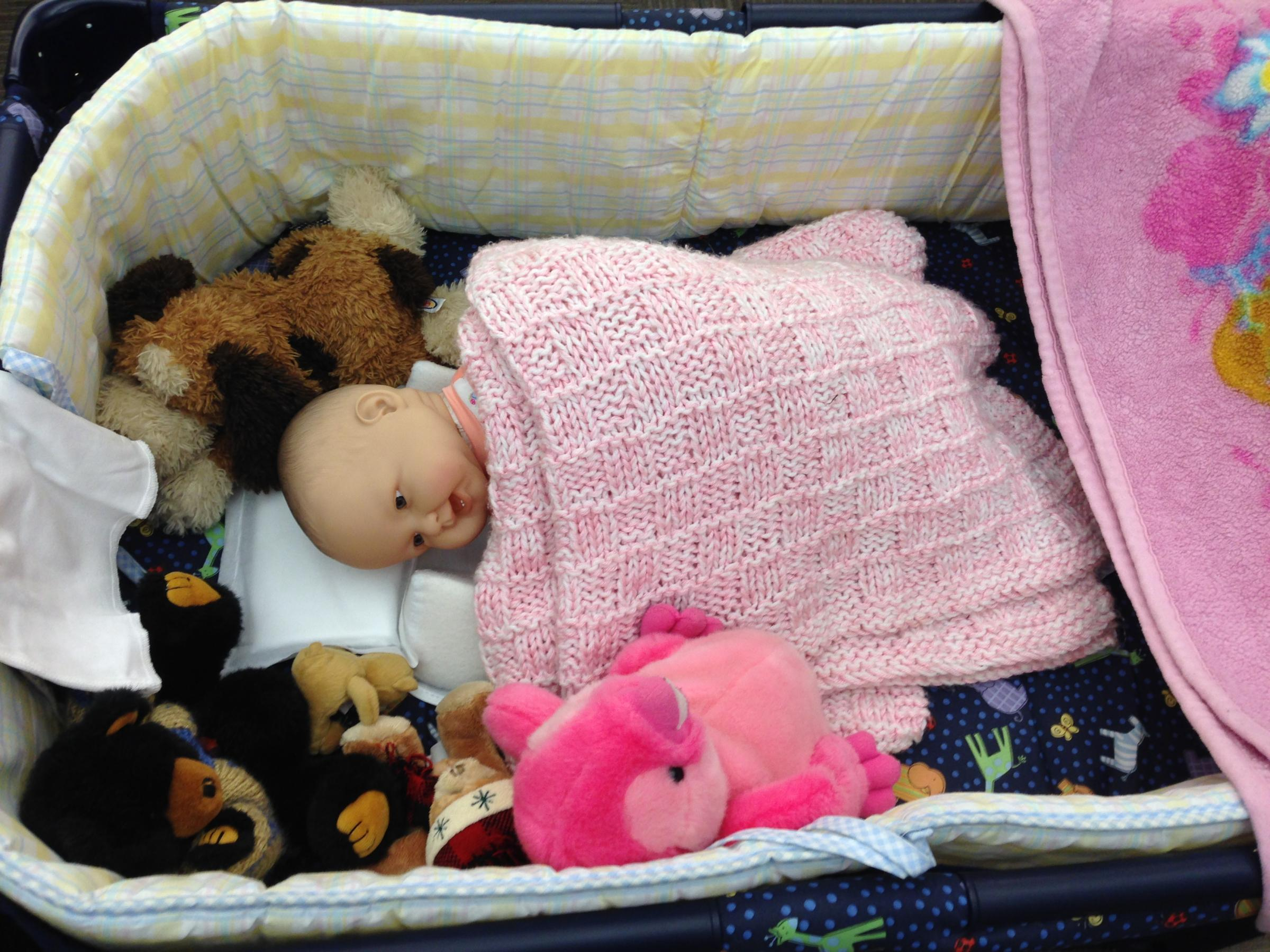 The safe sleep campaign urges parents not to keep a crib full of dangerous clutter