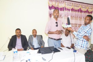Right-to-left; Mohamed Abdiwahab - SSG representative(Standing), Faisal khaliif - MAP chair, Mowlid Abkay - Director of the Puntland Ministry of information, posts, telecommunication, culture and heritage at the opening of the forum on Media's role in fostering good governance held at the new rays hotel in Garowe March 9th 2016.