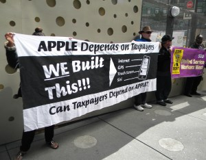 SEIU, United Service Workers West, organized a tax day community event outside the Apple flagship store off Market Street in San Francisco. Photo by PMWG staff 2014.