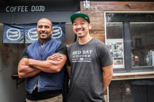 (L-R) Founder and chief executive officer of Red Bay Coffee company Keba Konte, 48 and chief operations officer Kori Chen, 31, stand in front of Garden Coffee Dojo, the company's roasting lab and production space in Oakland. (Photo by Ekevara Kitpowsong/Bay News Rising 2015)