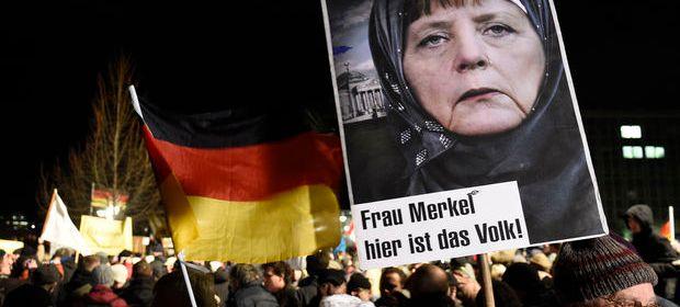Demonštranti v Drážďanoch počas protiislamských protestov. Autor: SITA/AP, Jens Meyer