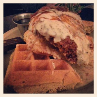 "Fried chicken & waffles with cream gravy, ""Henry's Hot Sauce,"" and maple syrup 14.99"