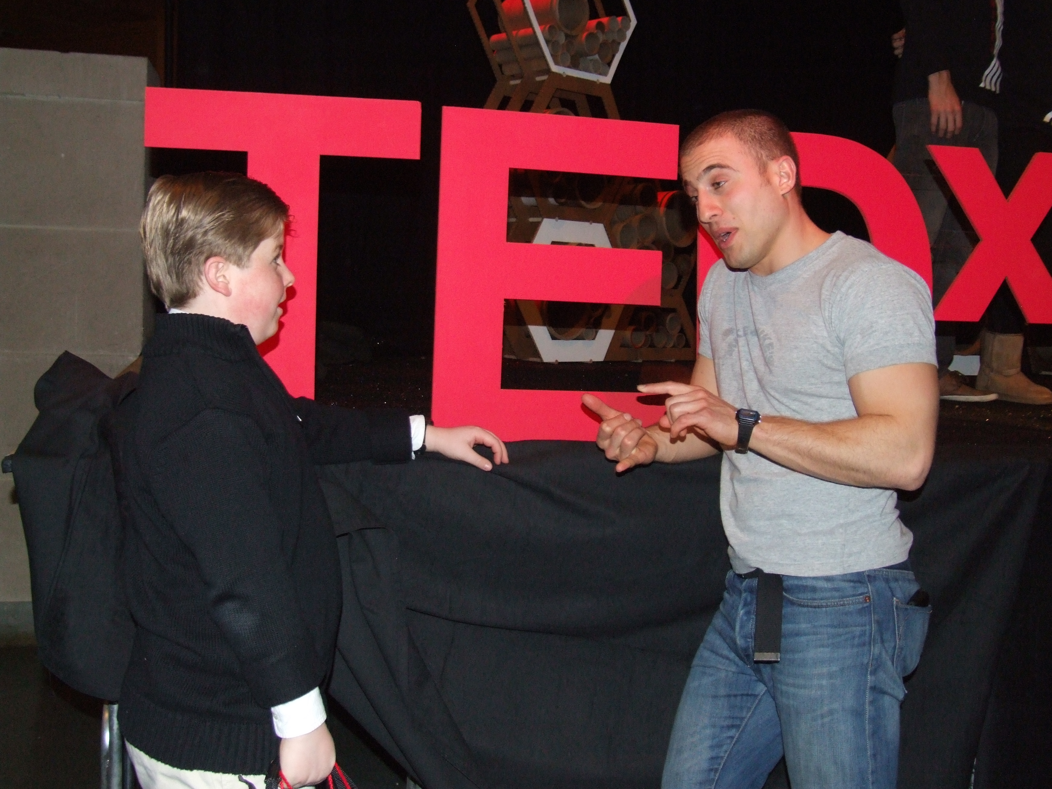 Chris Bashinelli talking with a young man at TEDx (Wake Forest Univ, NC)