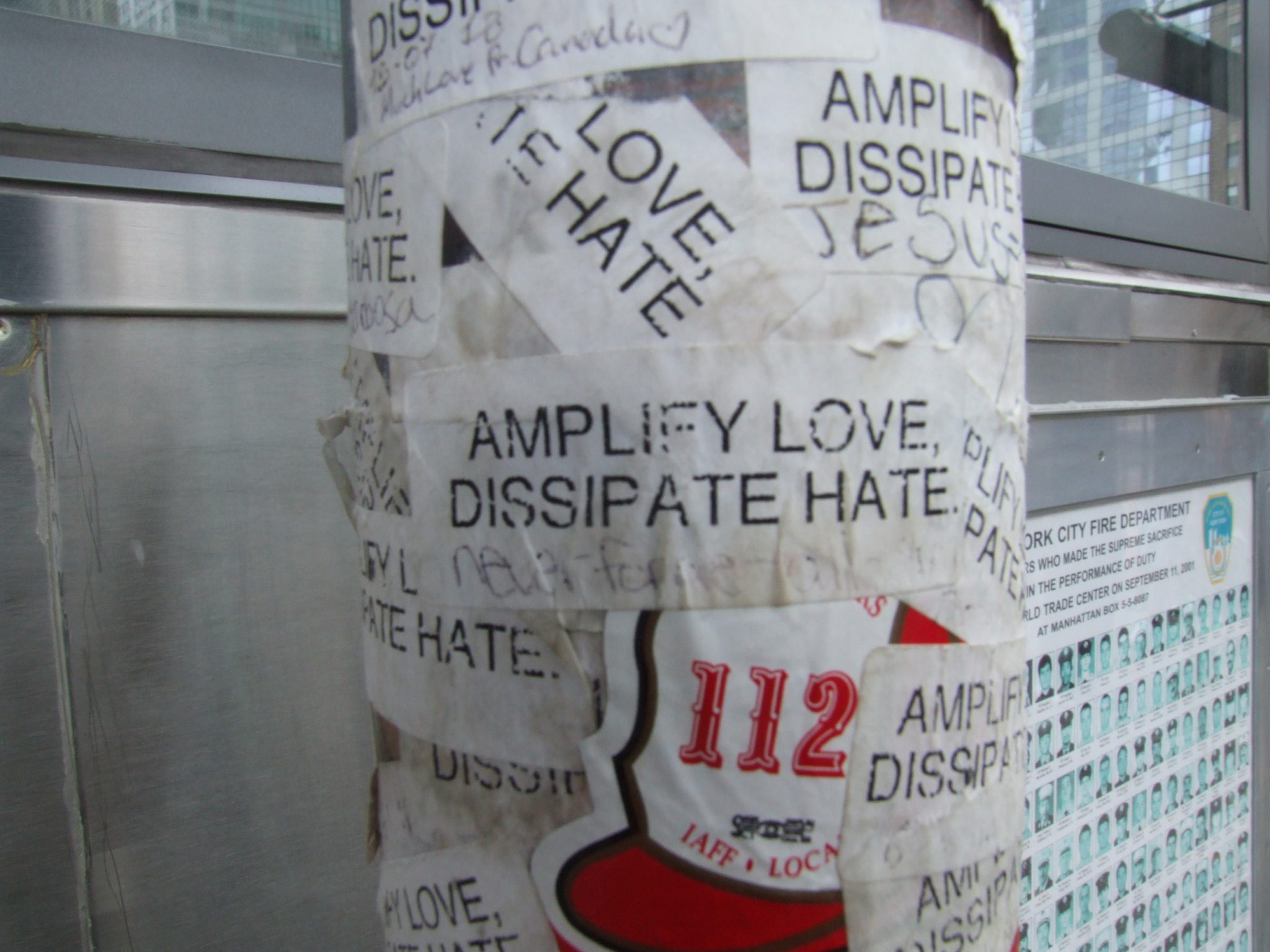 Amplify Love, Dissipate Hate. These stickers were plastered near a firehouse near the site.  I love that someone could still see the most important message of all despite the pain.