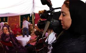 camera/woman documentary in Morocco