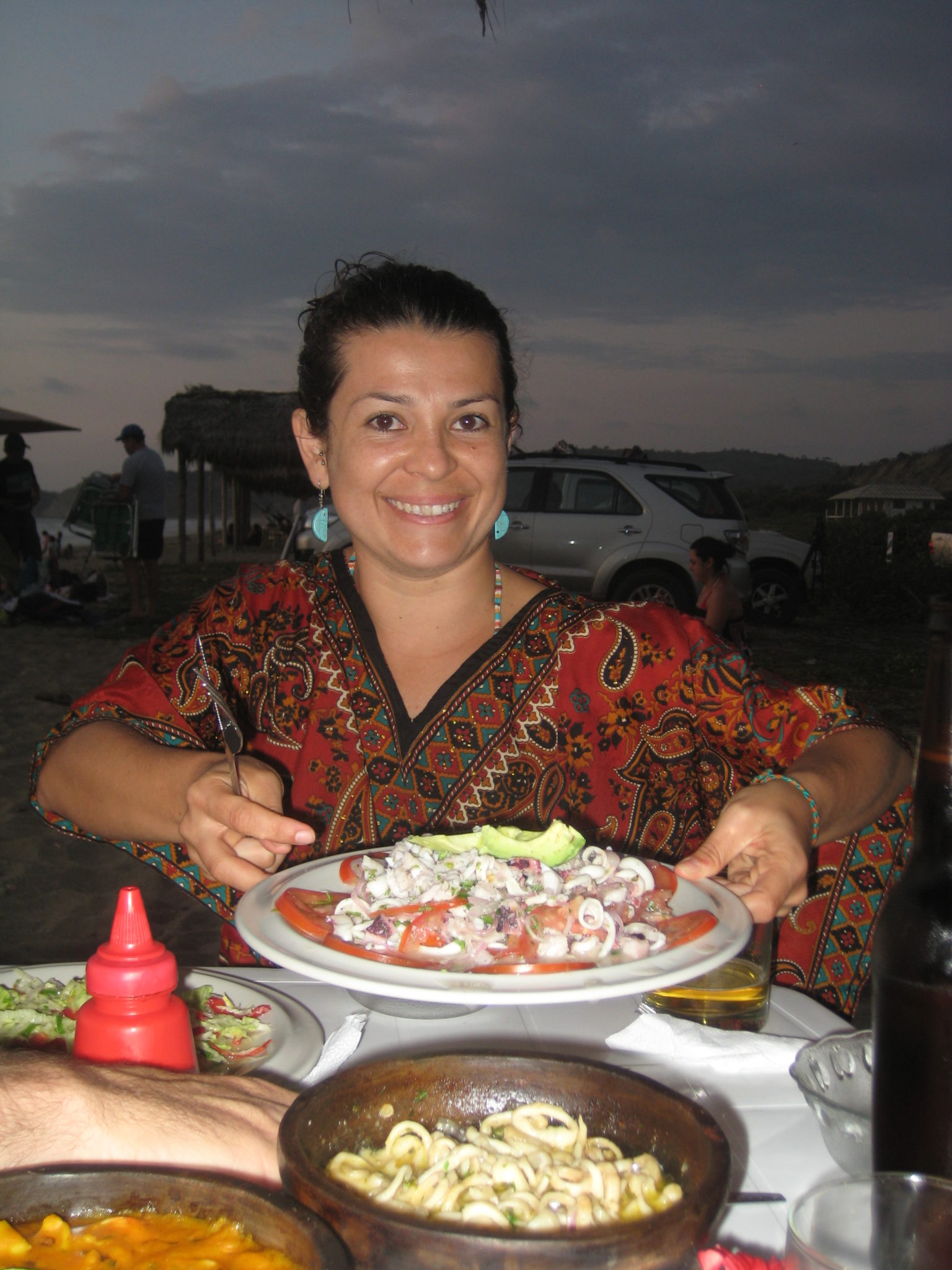 Our Ecuadorian friend, Maria Olga, with one of the many delicious seafood dishes we ate at the beach.